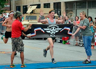 photo of a runner crossing the finish line